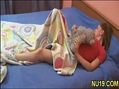 Stunning chick masturbates with tedd...