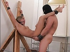 Young blonde honey loves being tortured and fucked up her as...