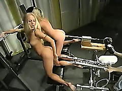 Pair of sexy blondes fucking eachother with huge fucking machines learning how to use big guns