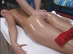 Hot oiled brunette being fucked