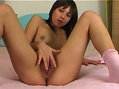 Finger fucking on the bed