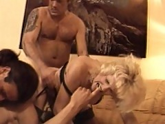 Young and old swinging couples in group sex