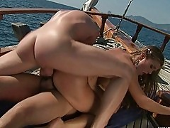 Lusty blonde chick jacks off two schlongs on the boat