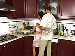 Man banging young housewife in kitchen