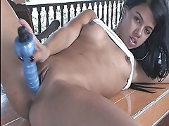 Tanned naughty angel shows her puss