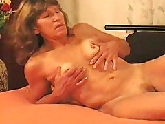 Horny MILF makes it with young stud 1/3